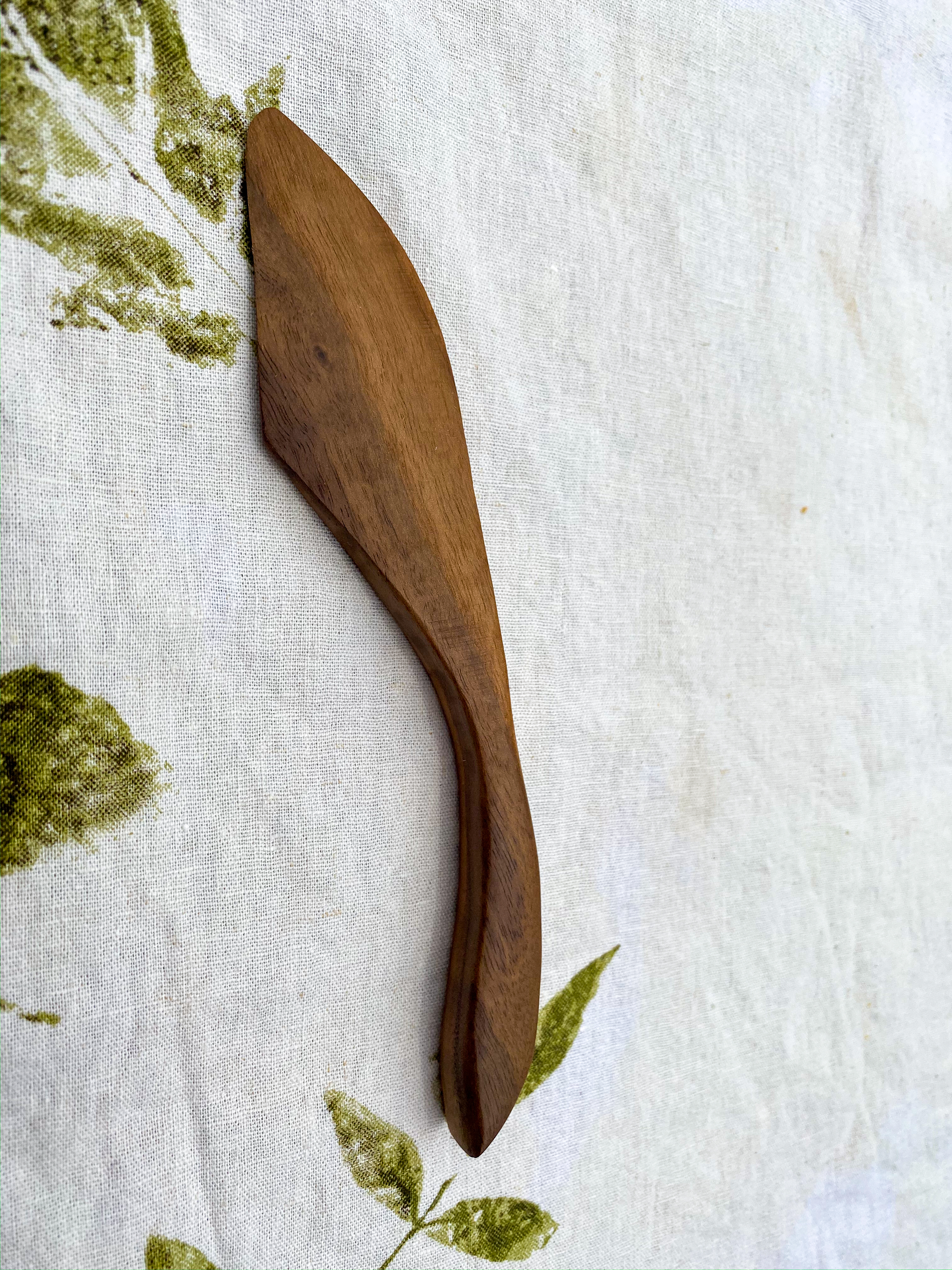 """Hand carved 8"""" x 2"""" walnut wood cheese knife."""